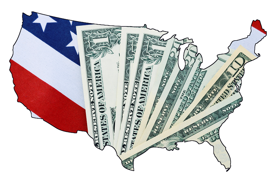USA Stars and Stripes flag and money within outline of USA map on white background for financial or tax day concept.