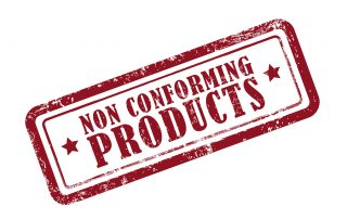 stamp non conforming products in red over white background