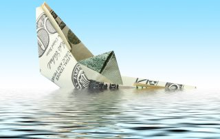 money ship wreck in water on blue